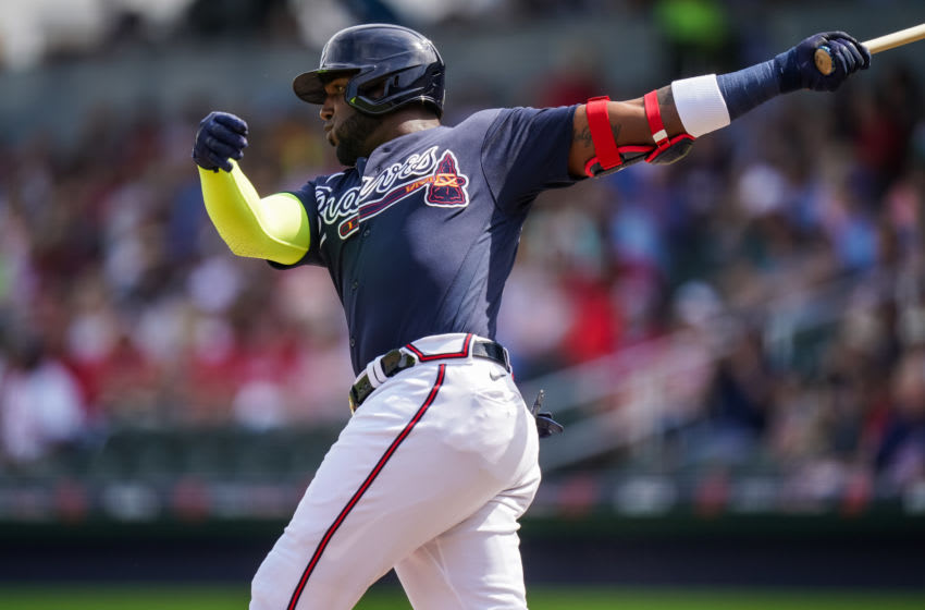 NORTH PORT, FL- FEBRUARY 25: Marcell Ozuna #20 of the Atlanta Braves bats during a spring training game against the Minnesota Twins on February 25, 2020 at CoolToday Park in North Port, Florida. (Photo by Brace Hemmelgarn/Minnesota Twins/Getty Images)