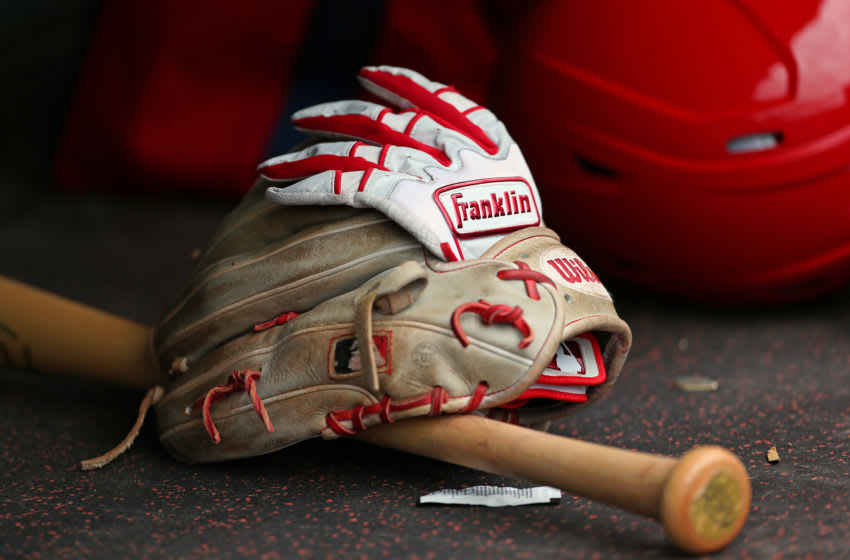 JUPITER, FL - MARCH 07: A Franklin batting glove and Wilson glove in the dugout of the St. Louis Cardinals during a spring training baseball game against the Houston Astros at Roger Dean Chevrolet Stadium on March 7, 2020 in Jupiter, Florida. The Cardinals defeated the Astros 5-1. (Photo by Rich Schultz/Getty Images)