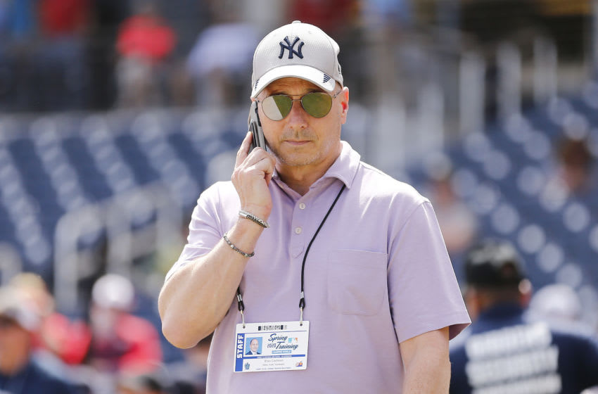 WEST PALM BEACH, FLORIDA - MARCH 12: New York Yankees general manager Brian Cashman talks on the phone prior to a Grapefruit League spring training game between the Washington Nationals and the New York Yankees at FITTEAM Ballpark of The Palm Beaches on March 12, 2020 in West Palm Beach, Florida. Many professional and college sports are canceling or postponing their games due to the ongoing threat of the Coronavirus (COVID-19) outbreak. (Photo by Michael Reaves/Getty Images)
