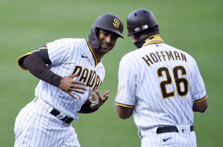 SAN DIEGO, CA - AUGUST 3: Trent Grisham #2 of the San Diego Padres is congratulated by third-base coach Glenn Hoffman #26 after hitting a solo home run during the first inning against the Los Angeles Dodgers at Petco Park August 3, 2020 in San Diego, California. (Photo by Denis Poroy/Getty Images)
