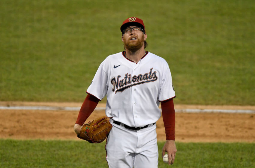 WASHINGTON, DC - AUGUST 05: Sean Doolittle #63 of the Washington Nationals walks to the dugout after being taken out of the game against the New York Mets in the seventh inning at Nationals Park on August 5, 2020 in Washington, DC. (Photo by Greg Fiume/Getty Images)