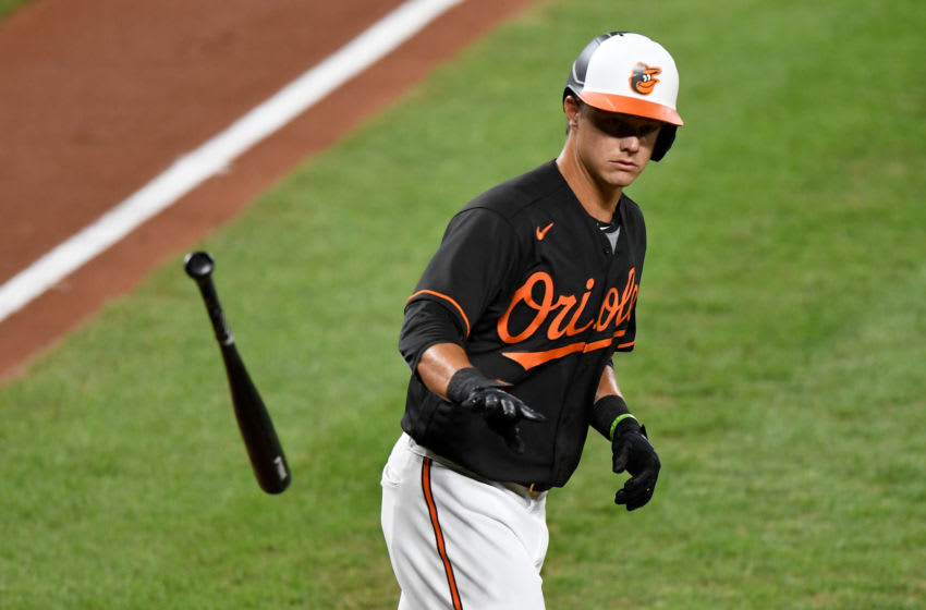 BALTIMORE, MD - AUGUST 21: Ryan Mountcastle #6 of the Baltimore Orioles tosses his bat after drawing a walk in the second inning of his MLB debut against the Boston Red Sox at Oriole Park at Camden Yards on August 21, 2020 in Baltimore, Maryland. (Photo by Greg Fiume/Getty Images)