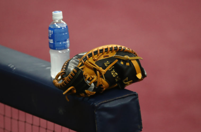 SEOUL, SOUTH KOREA - JUNE 06: Catcher's glove is seen at Kiwoom Heroes dugout ahead of the KBO League game between LG Twins and Kiwoom Heroes at the Gocheok Sky Dome on June 06, 2020 in Seoul, South Korea. (Photo by Chung Sung-Jun/Getty Images)