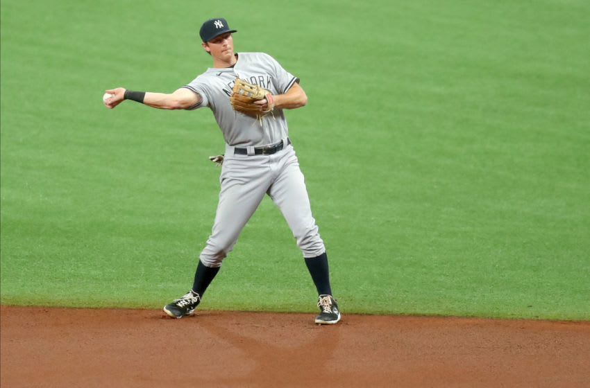 ST. PETERSBURG, FL - AUGUST 7: DJ LeMahieu #26 of the New York Yankees fields against the Tampa Bay Rays in the first inning of a baseball game at Tropicana Field on August 7, 2020 in St. Petersburg, Florida. (Photo by Mike Carlson/Getty Images)