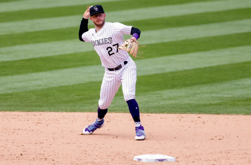 DENVER, CO - AUGUST 12: Trevor Story #27 of the Colorado Rockies throws to first base during the sixth inning against the Arizona Diamondbacks at Coors Field on August 12, 2020 in Denver, Colorado. (Photo by Justin Edmonds/Getty Images)