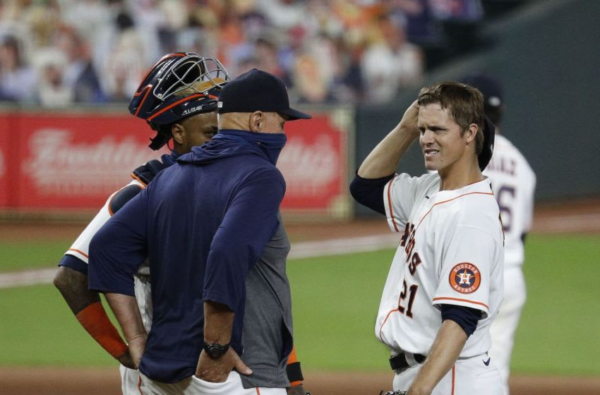 AUGUST 29: Houston Astros pitching coach Brent Strom talks with Zack Greinke #21 and Martin Maldonado #15 during game two of a doubleheader against the Oakland Athletics at Minute Maid Park on August 29, 2020 in Houston, Texas. (Photo by Bob Levey/Getty Images)