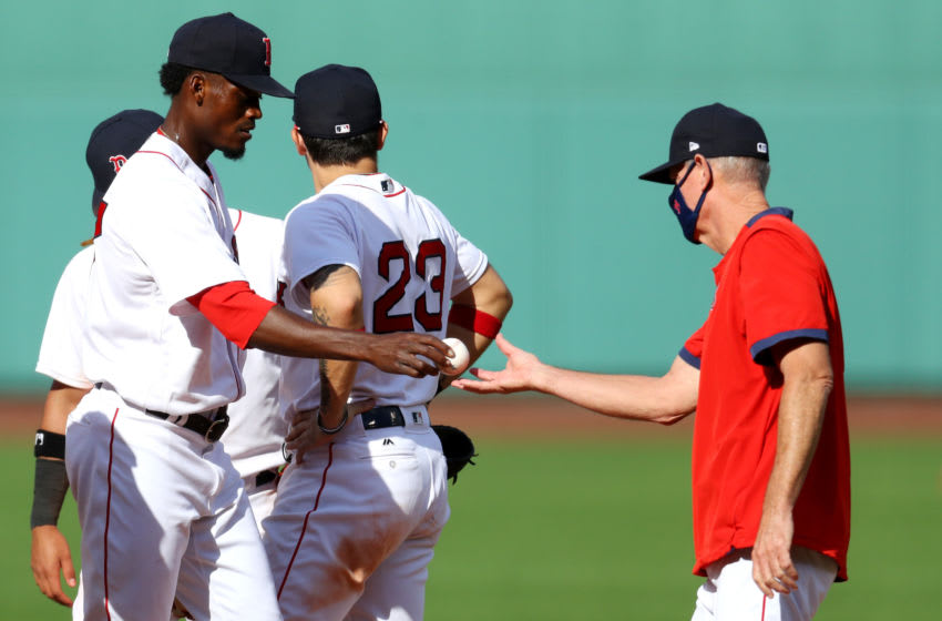 BOSTON, MASSACHUSETTS - SEPTEMBER 06: Boston Red Sox manager Ron Roenicke relieves Robinson Leyer #77 during the sixth inning against the Toronto Blue Jays at Fenway Park on September 06, 2020 in Boston, Massachusetts. (Photo by Maddie Meyer/Getty Images)