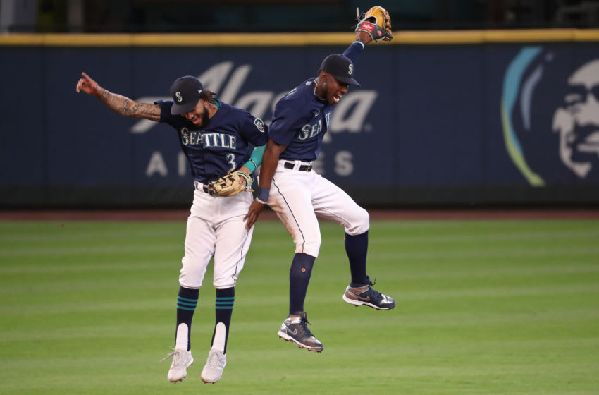 SEATTLE, WASHINGTON - SEPTEMBER 07: J.P. Crawford #3 (L) and Kyle Lewis #1 of the Seattle Mariners celebrate their 8-4 win against the Texas Rangers at T-Mobile Park on September 07, 2020 in Seattle, Washington. (Photo by Abbie Parr/Getty Images)