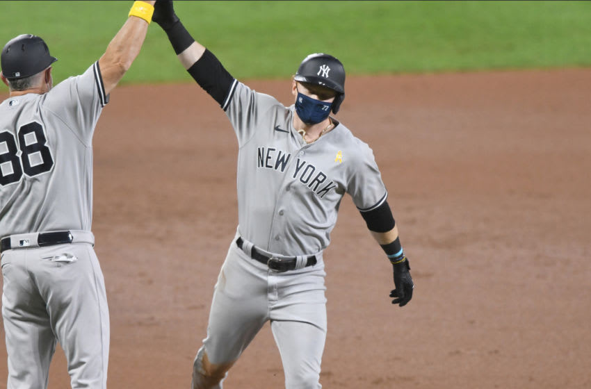 BALTIMORE, MD - SEPTEMBER 05: Clint Frazier #77 of the New York Yankees celebrates a home run with third base coach Phil Kevin #88 during a game baseball game against the Baltimore Orioles at Oriole Park at Camden Yards on September 5, 2020 in Baltimore, Maryland. (Photo by Mitchell Layton/Getty Images)