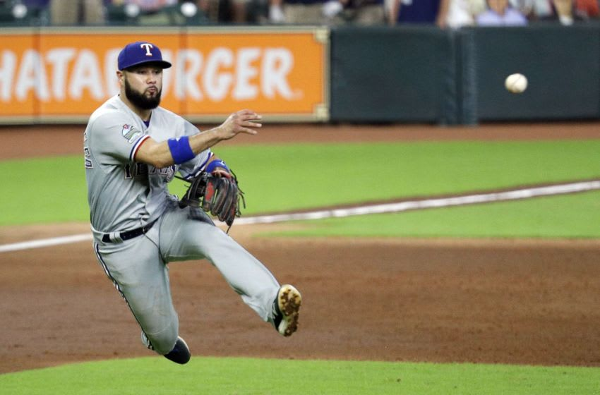 HOUSTON, TEXAS - SEPTEMBER 17: Isiah Kiner-Falefa of the Texas Rangers throws to first base to record an out. (Photo by Bob Levey/Getty Images)