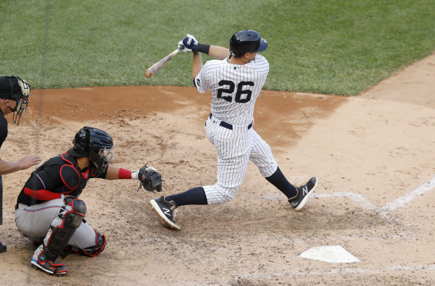 NEW YORK, NEW YORK - SEPTEMBER 26: (NEW YORK DAILIES OUT) DJ LeMahieu #26 of the New York Yankees follows through on a seventh inning run scoring base hit against the Miami Marlins at Yankee Stadium on September 26, 2020 in New York City. The Yankees defeated the Marlins 11-4. (Photo by Jim McIsaac/Getty Images)