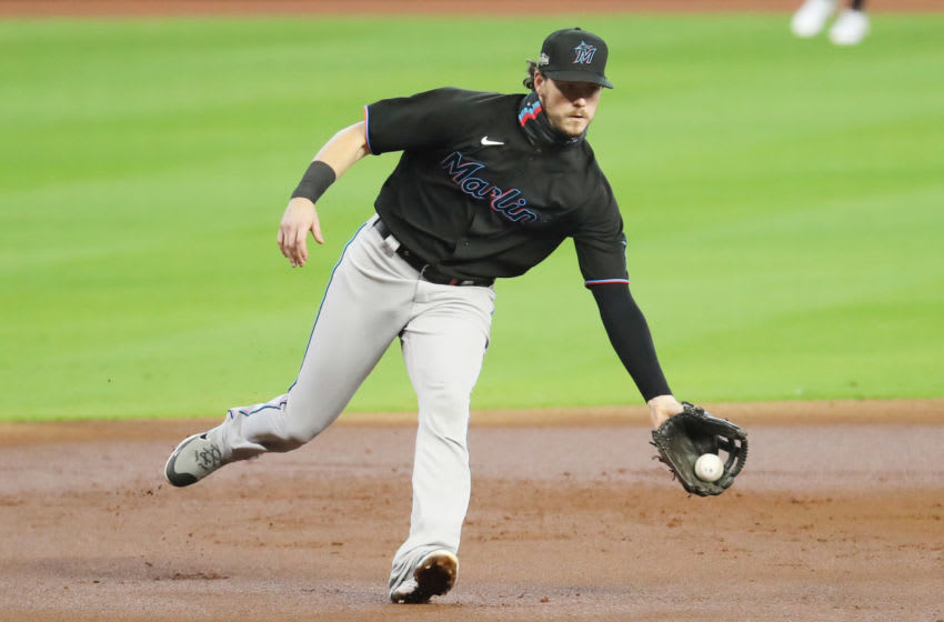 HOUSTON, TEXAS - OCTOBER 07: Brian Anderson #15 of the Miami Marlins fields a ground ball during the second inning against the Atlanta Braves in Game Two of the National League Division Series at Minute Maid Park on October 07, 2020 in Houston, Texas. (Photo by Bob Levey/Getty Images)