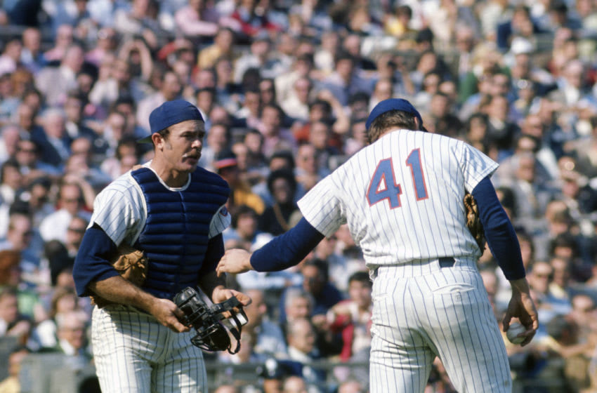 NEW YORK - CIRCA 1970: Catcher Jerry Grote #15 of the New York Mets comes out to talk with pitcher Tom Seaver #41 during an Major League Baseball game circa 1970 at Shea Stadium in the Queens borough of New York City. Grote played for the Mets from 1966-77. (Photo by Focus on Sport/Getty Images)