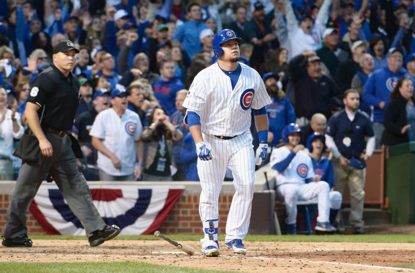 Kyle Schwarber #12 of the Chicago Cubs watches his solo home run in the seventh inning against the St. Louis Cardinals during game four of the National League Division Series at Wrigley Field on October 13, 2015 in Chicago, Illinois. (Photo by David Banks/Getty Images)