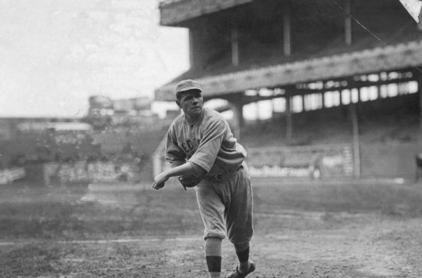 Babe Ruth, famous baseball player, in his lesser-known days as a Boston Red Sox player, where he was a pitcher. (Photo by George Rinhart/Corbis via Getty Images)