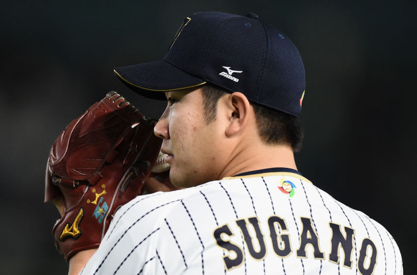 TOKYO, JAPAN - MARCH 14: Pitcher Tomoyuki Sugano #11 of Japan warms up prior to the World Baseball Classic Pool E Game Four between Cuba and Japan at the Tokyo Dome on March 14, 2017 in Tokyo, Japan. (Photo by Matt Roberts/Getty Images)
