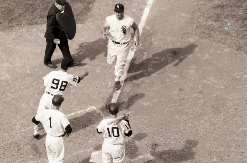 CHICAGO, IL - OCTOBER 1959: Ted Kluszewski #8 of the Chicago White Sox on his way to home plate after hitting a home run against the Los Angeles Dodgers during Game 1 of the 1959 World Series on October 1, 1959 in Chicago, Illinois. (Photo by Herb Scharfman/Sports Imagery/Getty Images)