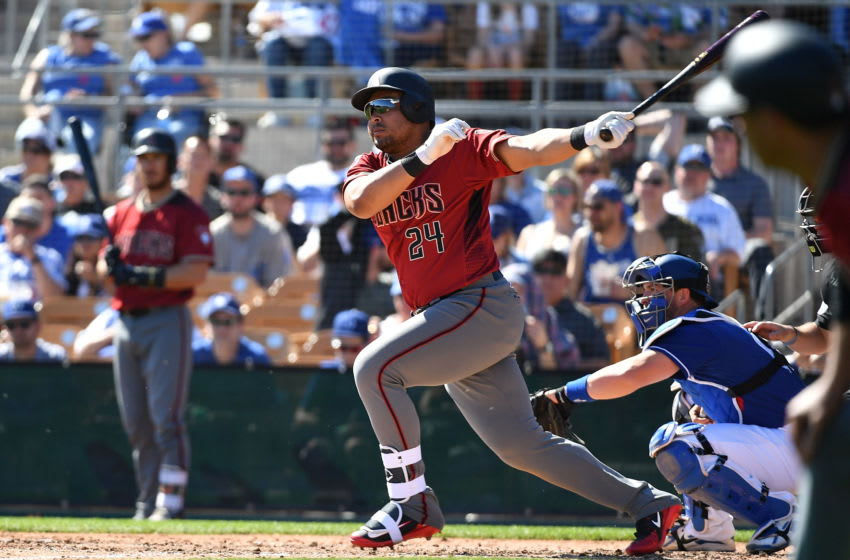 GLENDALE, AZ - MARCH 03: Yasmany Tomas #24 of the Arizona Diamondbacks hits an RBI single in the third inning of a spring-training game against the Los Angeles Dodgers at Camelback Ranch on March 3, 2018 in Glendale, Arizona. (Photo by Jennifer Stewart/Getty Images)