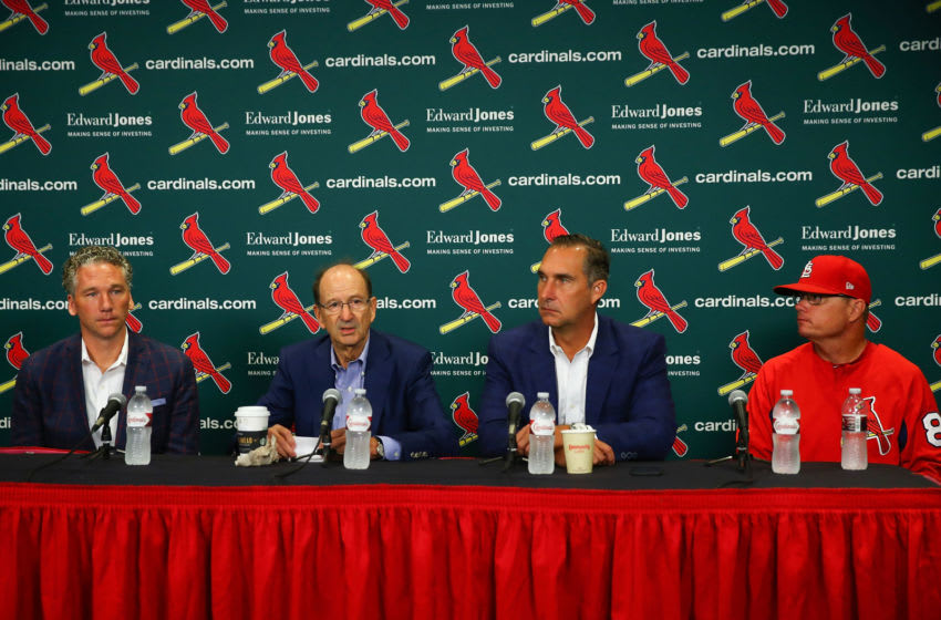 ST. LOUIS, MO - JULY 15: (L to R) Mike Girsch, general manager of the St. Louis Cardinals; Bill DeWitt Jr., managing partner and chairman of the St. Louis Cardinals; John Mozeliak, President of Baseball Operations of the St. Louis Cardinals and Mike Schildt, interim manager of the St. Louis Cardinals addressing a change in the manager during a press conference prior to a game between the St. Louis Cardinals and the Cincinnati Reds at Busch Stadium on July 15, 2018 in St. Louis, Missouri. (Photo by Dilip Vishwanat/Getty Images)