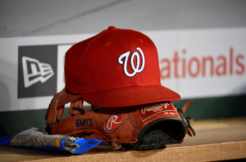 WASHINGTON, DC - SEPTEMBER 25: A general view of a Washington Nationals baseball hat on top of a Rawlings baseball glove during the game against the Philadelphia Phillies at Nationals Park on September 25, 2019 in Washington, DC. (Photo by Will Newton/Getty Images)