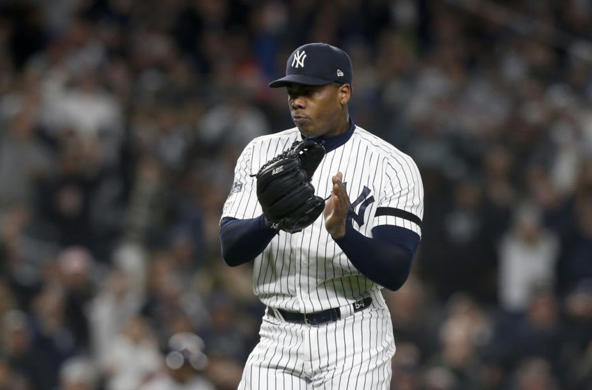 NEW YORK, NEW YORK - OCTOBER 18: (NEW YORK DAILIES OUT) Aroldis Chapman #54 of the New York Yankees in action against the Houston Astros in game five of the American League Championship Series at Yankee Stadium on October 18, 2019 in New York City. The Yankees defeated the Astros 4-1. (Photo by Jim McIsaac/Getty Images)