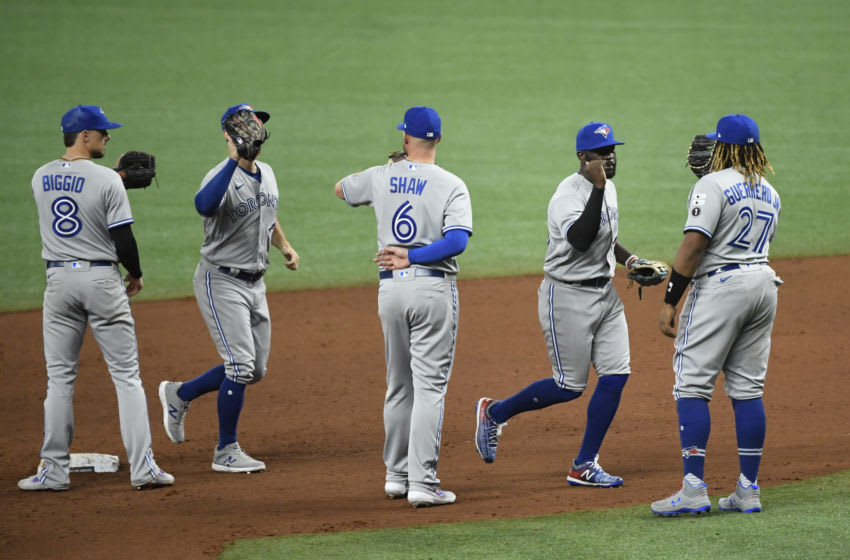 ST PETERSBURG, FLORIDA - JULY 24: Cavan Biggio #8 of the Toronto Blue Jays, Travis Shaw #6, and Vladimir Guerrero Jr. #27 celebrate with teammates after defeating the Tampa Bay Rays on Opening Day at Tropicana Field on July 24, 2020 in St Petersburg, Florida. The 2020 season had been postponed since March due to the COVID-19 pandemic. (Photo by Douglas P. DeFelice/Getty Images)