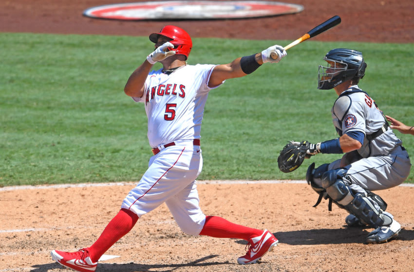 ANAHEIM, CA - AUGUST 02: Albert Pujols #5 of the Los Angeles Angels hits a grand slam home run as Dustin Garneau #13 of the Houston Astros looks on in the third inning of the game of Anaheim on August 2, 2020 in Anaheim, California. (Photo by Jayne Kamin-Oncea/Getty Images)