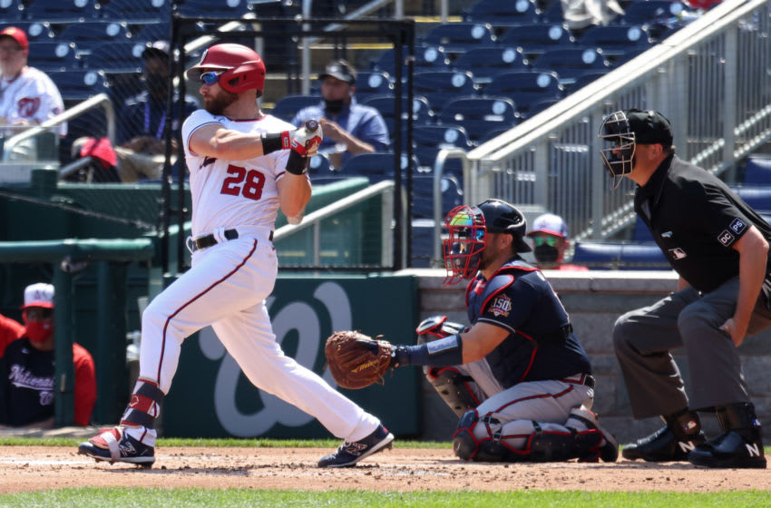 Apr 7, 2021; Washington, District of Columbia, USA; Washington Nationals catcher Jonathan Lucroy (28) hits a single against the Atlanta Braves in the first inning at Nationals Park. Mandatory Credit: Geoff Burke-USA TODAY Sports