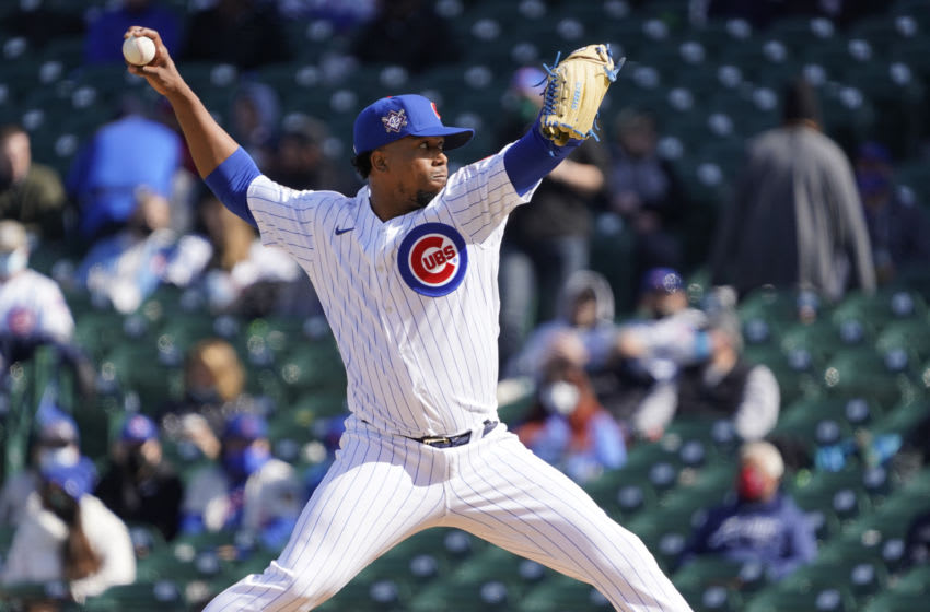 Apr 16, 2021; Chicago, Illinois, USA; Chicago Cubs relief pitcher Pedro Strop throws against the Atlanta Braves during the sixth inning at Wrigley Field. All players on both teams are wearing number 42 in honor of Jackie Robinson Day. Mandatory Credit: David Banks-USA TODAY Sports