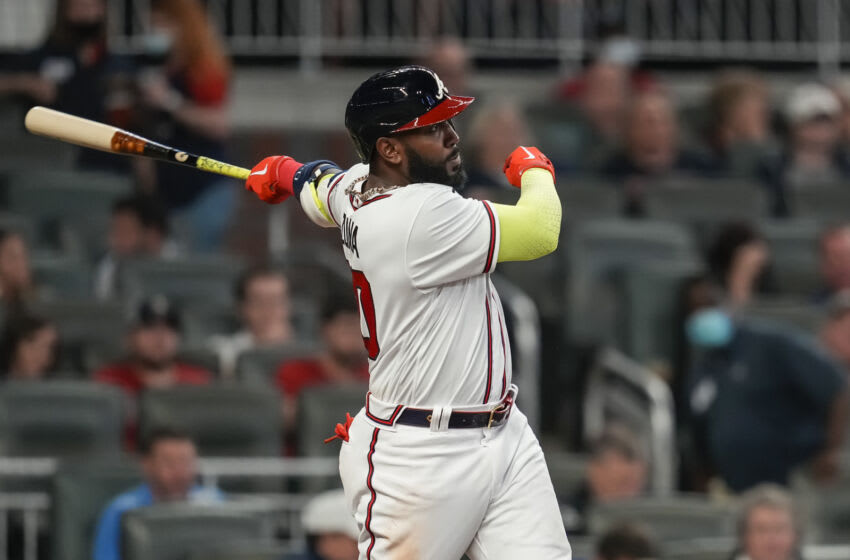 May 11, 2021; Cumberland, Georgia, USA; Atlanta Braves left fielder Marcell Ozuna (20) hits a home run against the Toronto Blue Jays during the sixth inning at Truist Park. Mandatory Credit: Dale Zanine-USA TODAY Sports