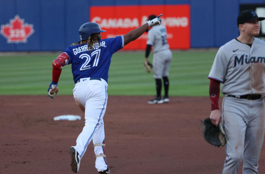 Jun 1, 2021; Buffalo, New York, USA; Toronto Blue Jays first baseman Vladimir Guerrero Jr. (27) celebrates his home run during the third inning against the Miami Marlins at Sahlen Field. Mandatory Credit: Timothy T. Ludwig-USA TODAY Sports