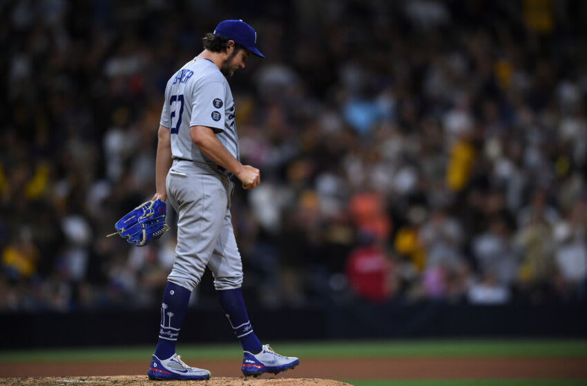 Jun 23, 2021; San Diego, California, USA; Los Angeles Dodgers starting pitcher Trevor Bauer (27) looks on after giving up a home run to San Diego Padres catcher Victor Caratini (not pictured) during the seventh inning at Petco Park. Mandatory Credit: Orlando Ramirez-USA TODAY Sports