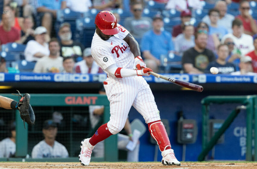 Jun 29, 2021; Philadelphia, Pennsylvania, USA; Philadelphia Phillies center fielder Andrew McCutchen (22) hits an RBI single against the Miami Marlins during the first inning at Citizens Bank Park. Mandatory Credit: Bill Streicher-USA TODAY Sports