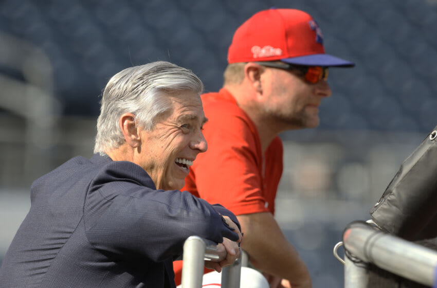 Jul 31, 2021; Pittsburgh, Pennsylvania, USA; Philadelphia Phillies president of baseball operations Dave Dombrowski (left) reacts at the batting cage before the Phillies play the Pittsburgh Pirates at PNC Park. Mandatory Credit: Charles LeClaire-USA TODAY Sports