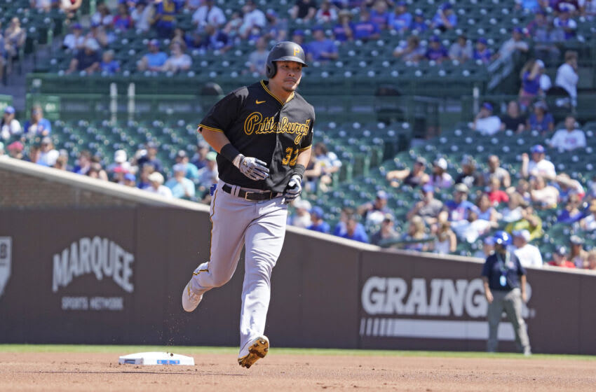 Sep 5, 2021; Chicago, Illinois, USA; Pittsburgh Pirates right fielder Yoshi Tsutsugo (32) runs the bases after hitting a home run against the Chicago Cubs during the first inning at Wrigley Field. Mandatory Credit: David Banks-USA TODAY Sports