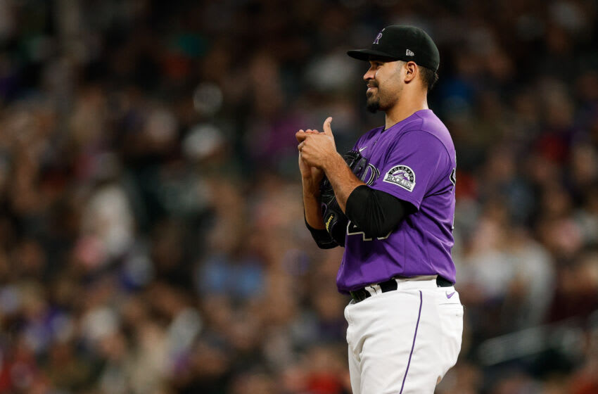 Sep 21, 2021; Denver, Colorado, USA; Colorado Rockies starting pitcher Antonio Senzatela (49) reacts on the mound in the fifth inning against the Los Angeles Dodgers at Coors Field. Mandatory Credit: Isaiah J. Downing-USA TODAY Sports