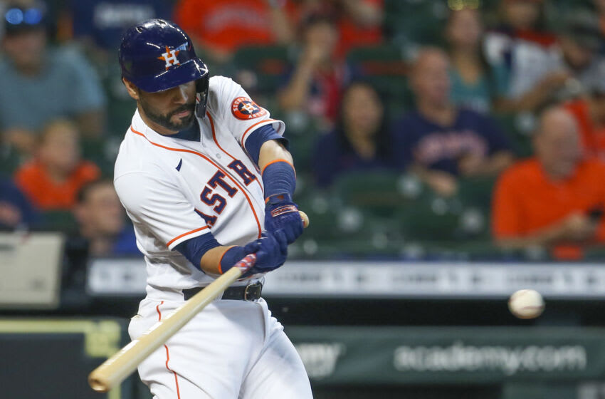 Sep 8, 2021; Houston, Texas, USA; Houston Astros third baseman Marwin Gonzalez (9) hits a two run home run against the Seattle Mariners in the second inning at Minute Maid Park. Mandatory Credit: Thomas Shea-USA TODAY Sports
