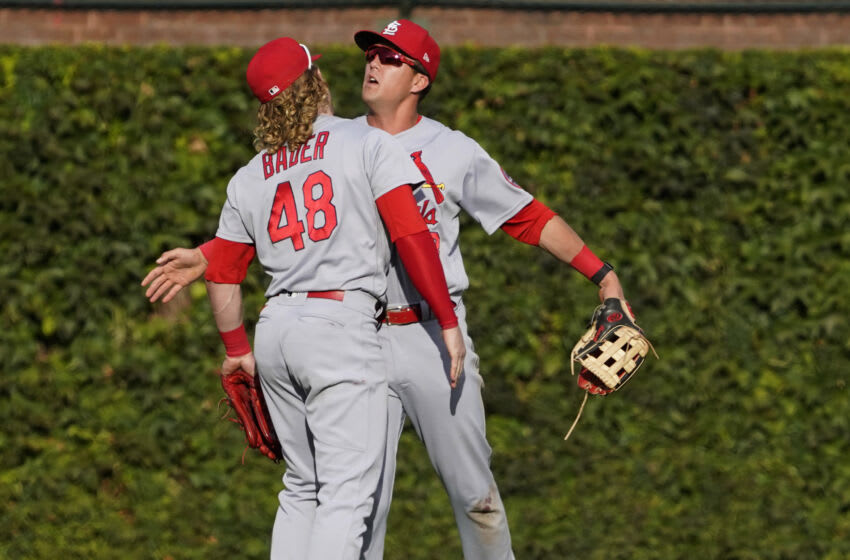 Sep 26, 2021; Chicago, Illinois, USA; St. Louis Cardinals center fielder Harrison Bader (48) and right fielder Lars Nootbaar (68) celebrate their win against the Chicago Cubs at Wrigley Field. Mandatory Credit: David Banks-USA TODAY Sports
