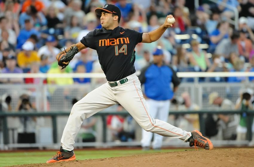 Jun 13, 2015; Omaha, NE, USA; Miami Hurricanes pitcher Danny Garcia (14) pitches in the 2015 College World Series at TD Ameritrade Park. Mandatory Credit: Steven Branscombe-USA TODAY Sports