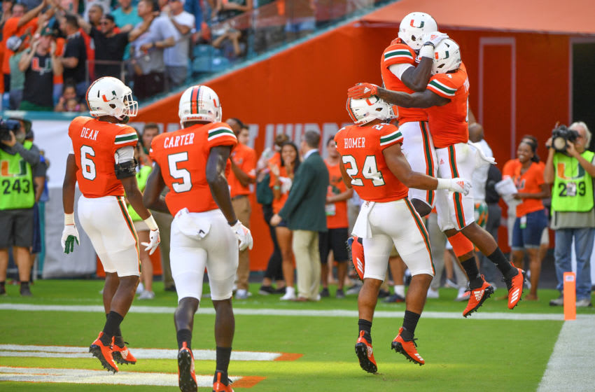 MIAMI, FL - SEPTEMBER 22: (L-R) Jhavonte Dean #6, Amari Carter #5, and Travis Homer #24 of the Miami celebrate with Jeff Thomas #4 of the Miami Hurricanes after returning a punt for a touchdown in the first quarter against the Florida International Golden Panthers at Hard Rock Stadium on September 22, 2018 in Miami, Florida. (Photo by Mark Brown/Getty Images)