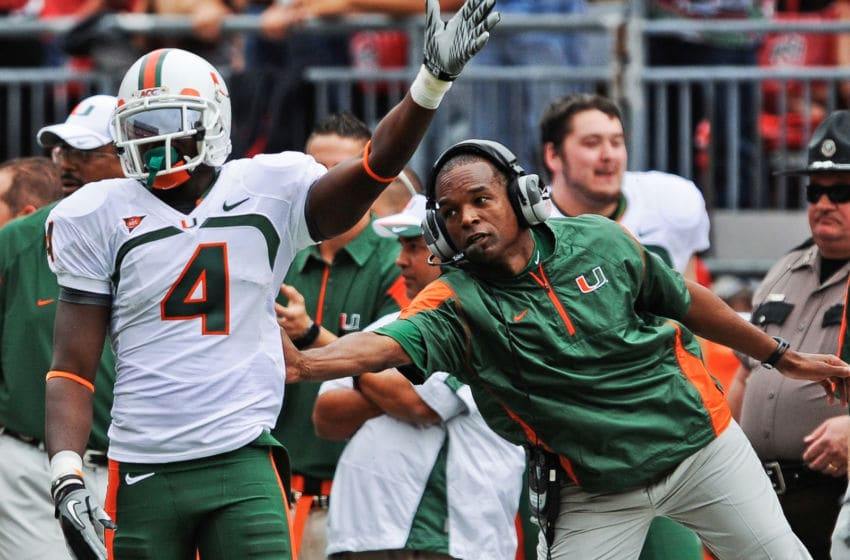 COLUMBUS, OH - SEPTEMBER 11: Head Coach Randy Shannon of the Miami Hurricanes congratulates Aldarius Johnson #4 of the Hurricanes after a first down catch against the Ohio State Buckeyes at Ohio Stadium on September 11, 2010 in Columbus, Ohio. (Photo by Jamie Sabau/Getty Images)