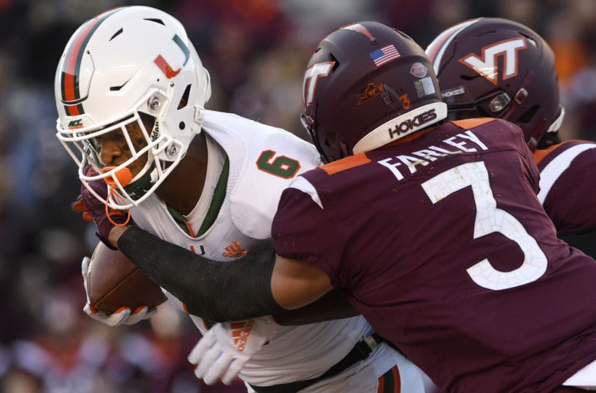 BLACKSBURG, VA - NOVEMBER 17: Defensive back Caleb Farley #3 of the Virginia Tech Hokies hits wide receiver Mark Pope #6 of the Miami Hurricanes following his reception in the first half at Lane Stadium on November 17, 2018 in Blacksburg, Virginia. (Photo by Michael Shroyer/Getty Images)