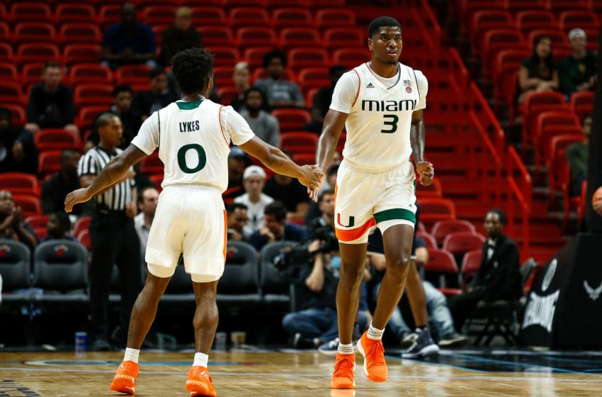 MIAMI, FL - DECEMBER 01: Chris Lykes #0 and Anthony Lawrence II #3 of the Miami Hurricanes celebrate against the Yale Bulldogs during the HoopHall Miami Invitational at American Airlines Arena on December 1, 2018 in Miami, Florida. (Photo by Michael Reaves/Getty Images)