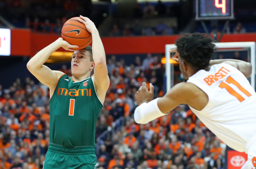 SYRACUSE, NY - JANUARY 24: Dejan Vasiljevic #1 of the Miami Hurricanes shoots the ball around Oshae Brissett #11 of the Syracuse Orange during the first half at the Carrier Dome on January 24, 2019 in Syracuse, New York. (Photo by Rich Barnes/Getty Images)