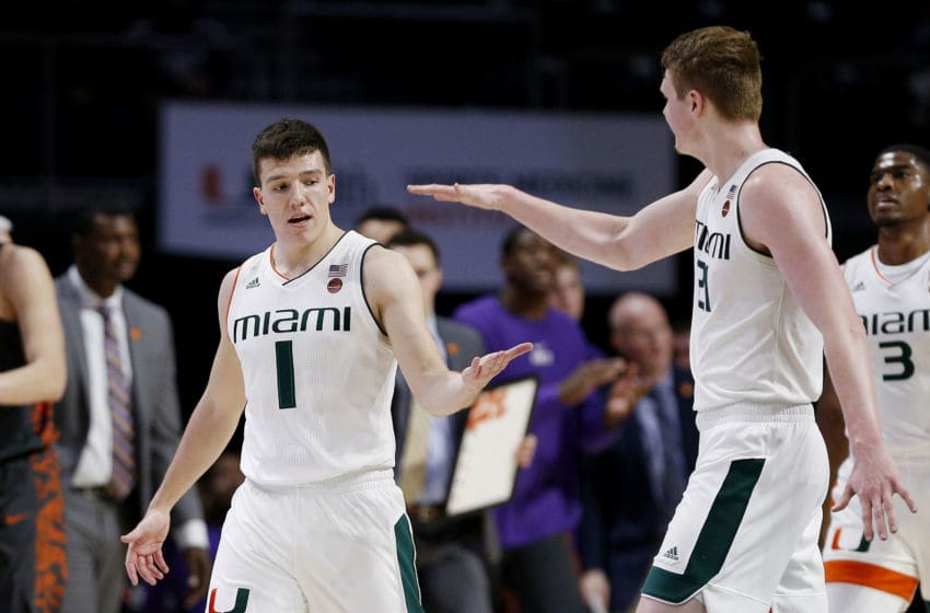 MIAMI, FLORIDA - FEBRUARY 13: Dejan Vasiljevic #1 of the Miami Hurricanes celebrates with Sam Waardenburg #21 against the Clemson Tigers at the Watsco Center on February 13, 2019 in Miami, Florida. (Photo by Michael Reaves/Getty Images)