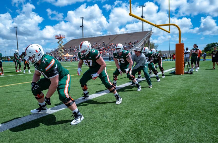 MIAMI, FL - APRIL 13: Miami Hurricanes offensive line performs drills with Assistant and Offensive Line coach Butch Barry before the annual Spring Game at Nathaniel Traz-Powell Stadium on April 13, 2019 in Miami, Florida. (Photo by Mark Brown/Getty Images)