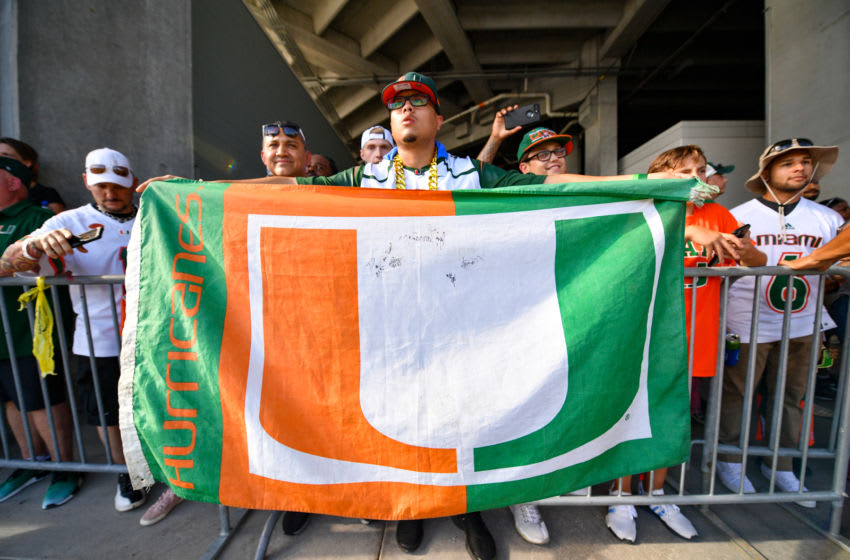 ORLANDO, FL - AUGUST 24: A fan of the Miami Hurricanes displays The U flag as the team arrives at the stadium before the game between the Florida Gators and the Miami Hurricanes for the Camping World Kickoff at Camping World Stadium on August 24, 2019 in Orlando, Florida. (Photo by Mark Brown/Getty Images)