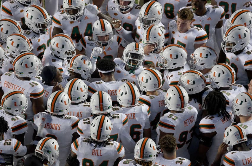 CHAPEL HILL, NORTH CAROLINA - SEPTEMBER 07: Teammates huddle around Gilbert Frierson #3 of the Miami Hurricanes before their game against the North Carolina Tar Heels at Kenan Stadium on September 07, 2019 in Chapel Hill, North Carolina. (Photo by Grant Halverson/Getty Images)