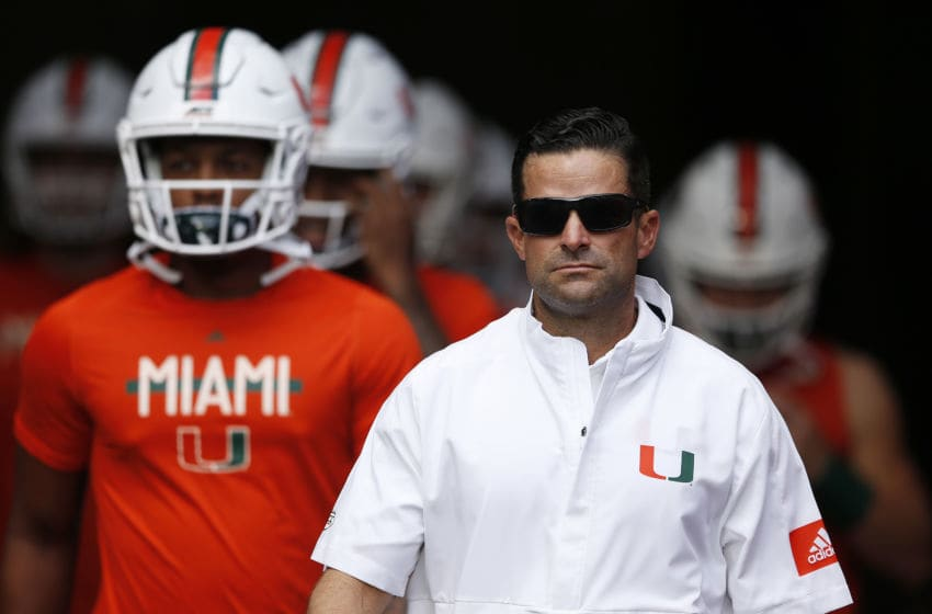 MIAMI, FLORIDA - SEPTEMBER 14: Head coach Manny Diaz of the Miami Hurricanes takes the field with Jarren Williams #15 prior to the game between the Miami Hurricanes and the Bethune Cookman Wildcats at Hard Rock Stadium on September 14, 2019 in Miami, Florida. (Photo by Michael Reaves/Getty Images)