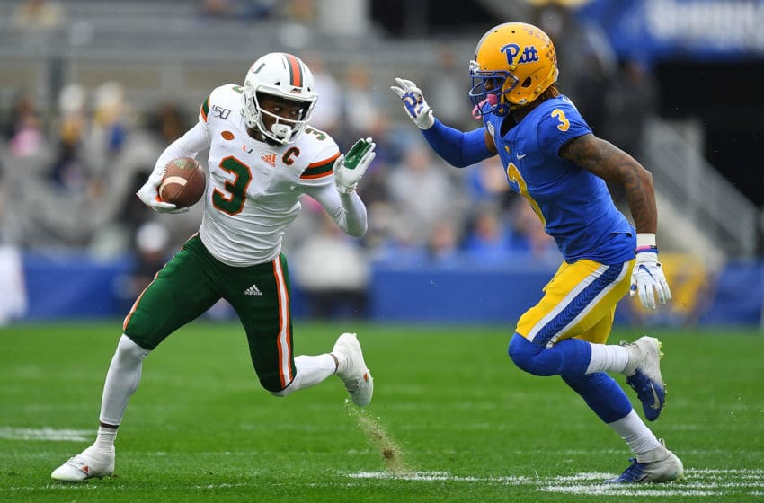 PITTSBURGH, PA - OCTOBER 26: Mike Harley #3 of the Miami Hurricanes carries the ball in front of Damar Hamlin #3 of the Pittsburgh Panthers during the first quarter at Heinz Field on October 26, 2019 in Pittsburgh, Pennsylvania. (Photo by Joe Sargent/Getty Images)